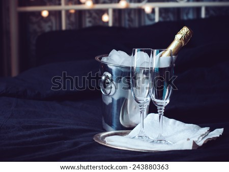 Two glasses full of sparkling champagne wine with golden decoration Stock photo © dash