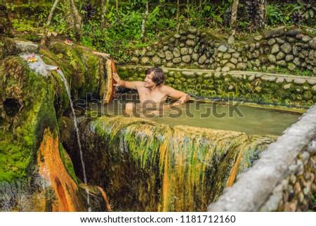 Man tourist in Belulang Hot Springs in Bali on the background of rice terraces Stock photo © galitskaya