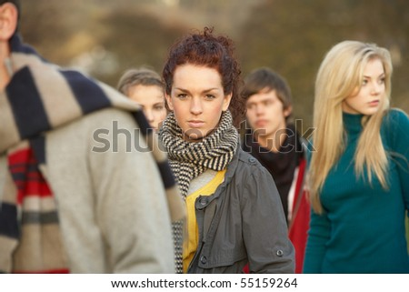 Teenage Girl Surrounded By Friends In Outdoor Autumn Landscape Stock photo © monkey_business