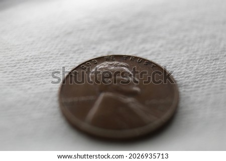 In God We Trust from the penny isolated on blue Stock photo © johnkwan