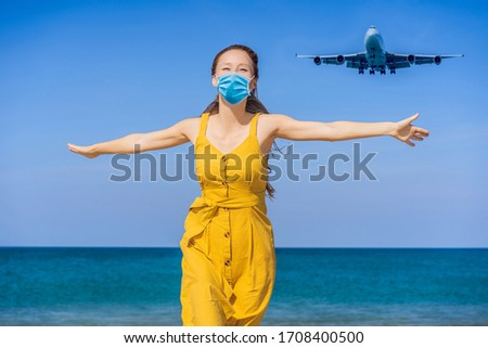 Woman in medical mask have fun on the beach watching the landing planes. Traveling on an airplane co Stock photo © galitskaya