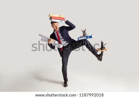 isolated stressed businessman at his desk working   white backgr stock photo © dacasdo