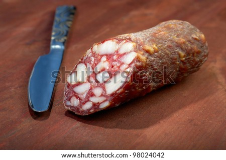 Sliced Sausage And Kitchen Knif Stok fotoğraf © Fanfo