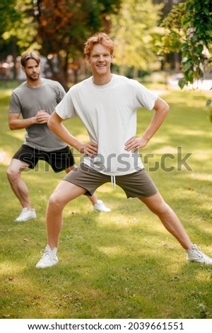 Fine looking guy doing excercises in park Stock photo © dash