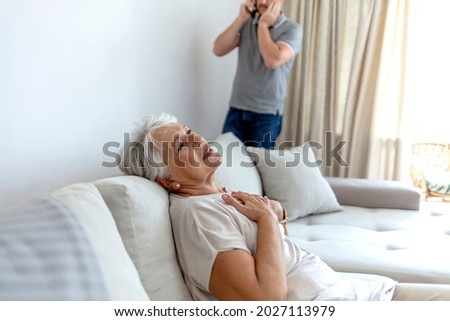 senior collapsed young woman calling help stock photo © Pasiphae