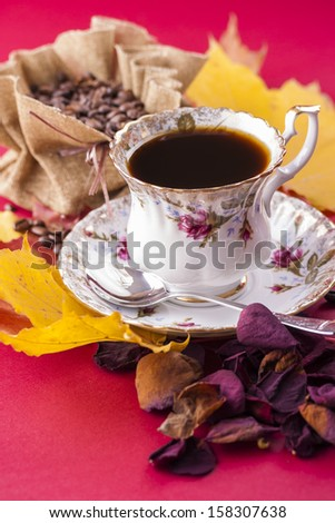 Autumn style close up photo of a hot coffee porcelain cup with the bag of the coffee beans over a re stock photo © MamaMia