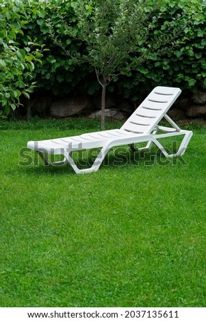 white lounge sunbeds standing on green grass in park photo Stock photo © Hermione