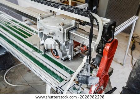 Water cooled floor tile cutting machine Stock photo © backyardproductions