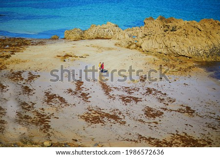 Couple kissing on a low wall, sea view Stock photo © IS2