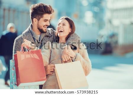 jóvenes · guapo · Pareja · caminando · compras · pasaje - foto stock © boggy