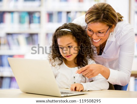 Schoolgirl researching online with the guidance of her teacher Stock photo © Lopolo