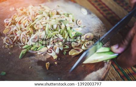 lemongrass slices on wood background. Stock photo © szefei