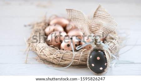 White and painted black egg decorated with a paper gold crown in a black cardboard box on a black ba Stock photo © artjazz
