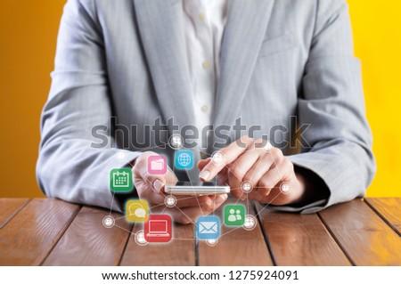 Businesswoman using phone with mail concept around Stock photo © ra2studio