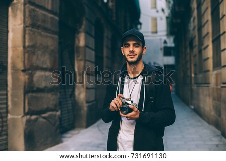 Man photographer with a photo camera in hand outdoor Stock photo © Illia