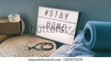 Coronavirus Yoga at home sign lightbox with text hashtag Hashtag STAYHOME glowing in light with exer Stock photo © Maridav