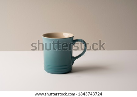 Tea cup home serving for one english black tea black tea with teapot and macarons cookies with lovel Stock photo © Maridav