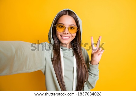 smiling girl in hood stock photo © simply