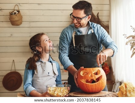 dad and his daughter carving pumpkins in the kitchen stock photo © photography33