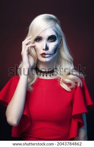 blonde model posing with a painted mask on her face Stock photo © carlodapino