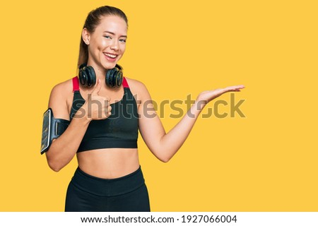 Portrait of confident young woman in sportswear holding a water  stock photo © HASLOO