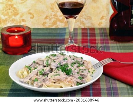 Sığır eti yumurta makarna şarap mum akşam yemeği Stok fotoğraf © rojoimages