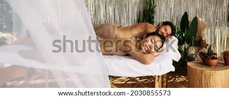 Indonesian couple having wellness massage Stock photo © Kzenon
