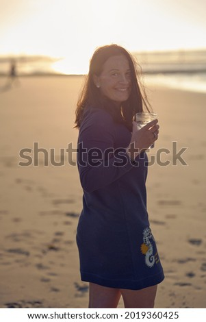Happy vivacious woman with a tropical cocktail Stock photo © dash