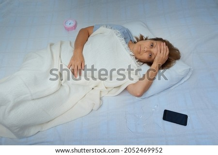 Mature woman cannot sleep at night time Stock photo © tab62