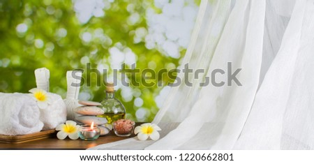 Stock photo: Composite image of Women with bottle and towel with bokeh