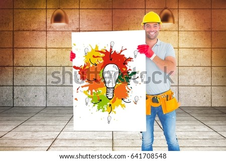 Stock photo: Carpenter holding billboard with painting while standing against wall