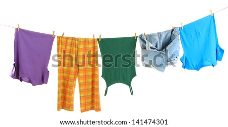 Blue jeans shorts with drying on clothesline isolated on white  Stock photo © kayros