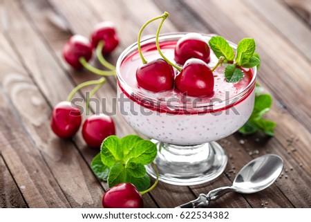 Fresh yogurt with cherry and chia seeds, delicious dessert for healthy breakfast stock photo © yelenayemchuk