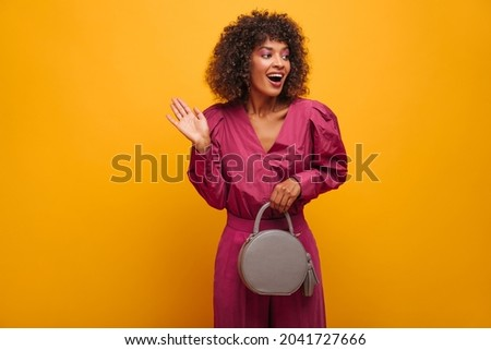 African woman with ladies handbag waving hand stock photo © studioworkstock