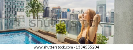 Young woman in the pool among the skyscrapers and the big city. Relax in the big city. Rest from str Stock photo © galitskaya