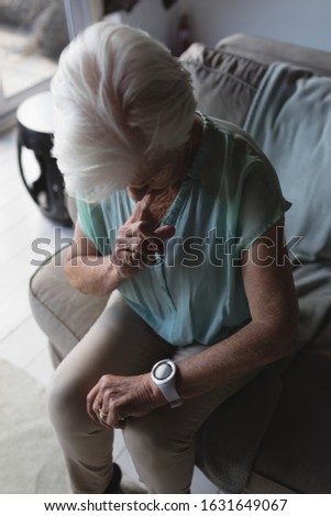 High angle view of a senior woman checking time on her wristwatch at home Stock photo © wavebreak_media