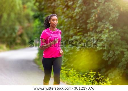 Summer running healthy active woman runner listening to music on phone sport armband with headphones Stock photo © Maridav