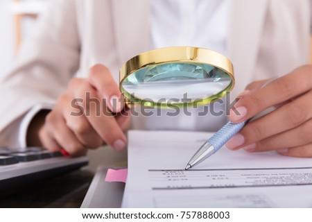 Businessperson Checking Bills Stock photo © AndreyPopov