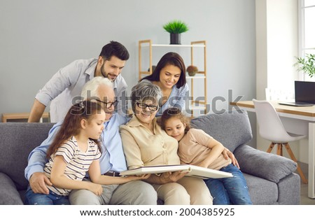 Couple Family Looking Photo Album Stock photo © AndreyPopov
