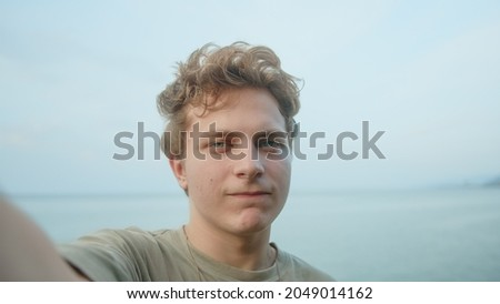 male teenager at the beach making phone call stock photo © photography33