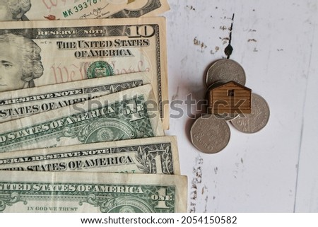 Miniature green house on US coins stock photo © sqback