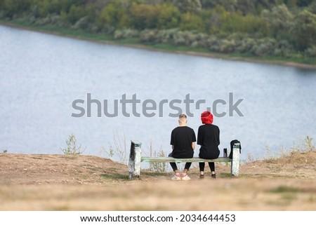 Tourists Couple contemplating on shore lake Stock photo © pixachi