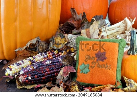 Pumpkins, leaves and Indian corn with a Give Thanks pillow. Stock photo © rojoimages
