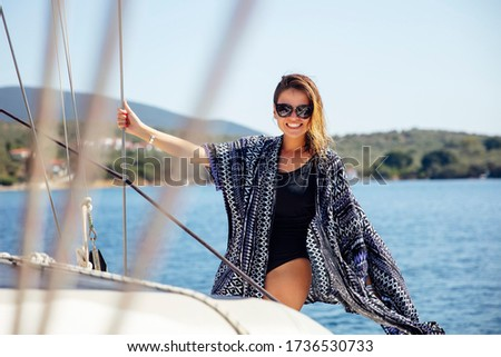Pretty young woman relaxing on the yacht on sea at sunny day Stock photo © boggy