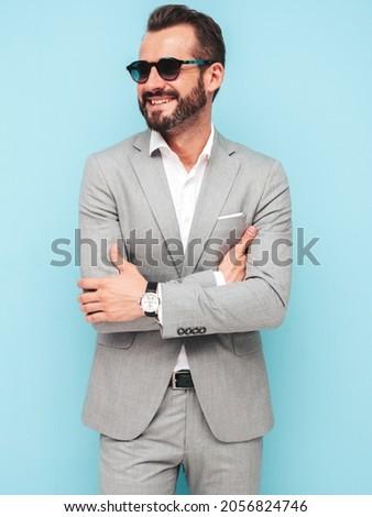 Sexy man posing at wall smiling stock photo © nyul