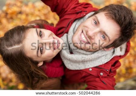 Teen couple at autumn park Stock photo © Lopolo
