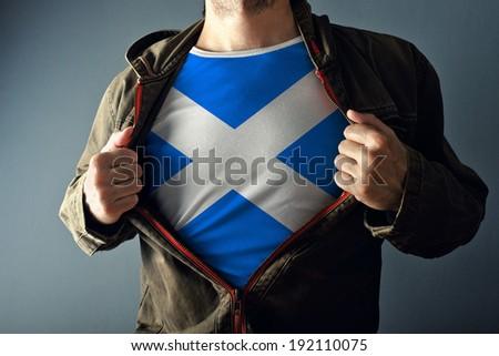 Man stretching jacket to reveal shirt with Scotland flag Stock photo © stevanovicigor