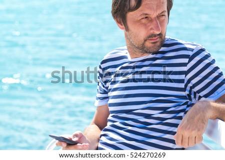 成人 男性 縞模様の 船乗り シャツ 携帯 ストックフォト © stevanovicigor