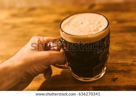 Man drinking dark beer in british dimpled glass pint mug Stock photo © stevanovicigor