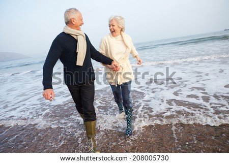 couple walking along autumn beach Stock photo © dolgachov